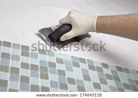 Man Tiling - stock photo