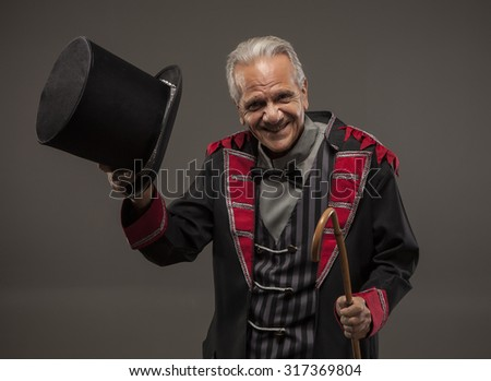 Man tipping hat as a ticket Seller, Retro American Carnival Barker - stock photo