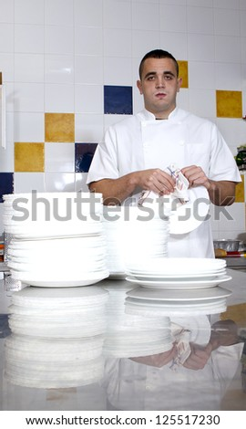 man tired drying dishes