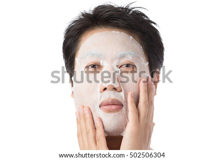 Man to put a face mask, skin care