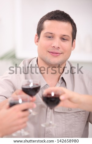 Man toasting with wine - stock photo