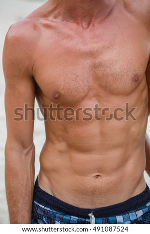 Man torso on the Beach
