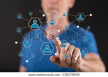 Man touching a social network on a touch screen with his finger