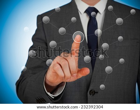 Man touching a virtual network screen - stock photo