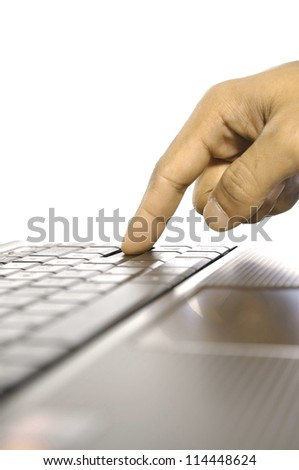 Man touching laptop button. Shot with shallow DOF