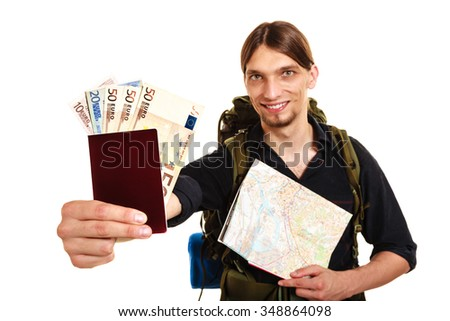 Man tourist backpacker holding map and passport full of money. Young guy hiker backpacking. Summer vacation travel. Studio shot. Isolated on white background. - stock photo