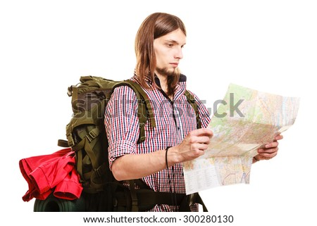 Man tourist backpacker reading map on trip. Young guy hiker searching looking for direction guide. Male backpacking. Summer vacation travel. Isolated on white background. - stock photo
