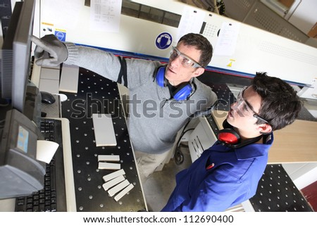 Man training a new recruit - stock photo