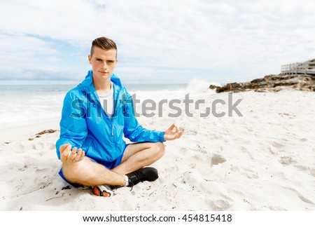 Man training on beach outside