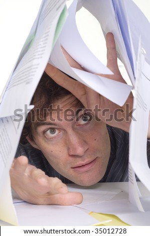 Man trapped under pile of paper work - stock photo
