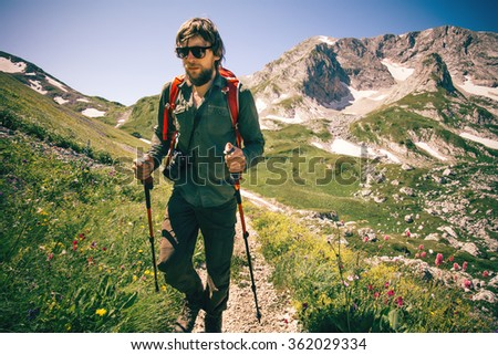 Man Traveler with backpack hiking outdoor Travel Lifestyle concept mountains on background Summer vacations  - stock photo