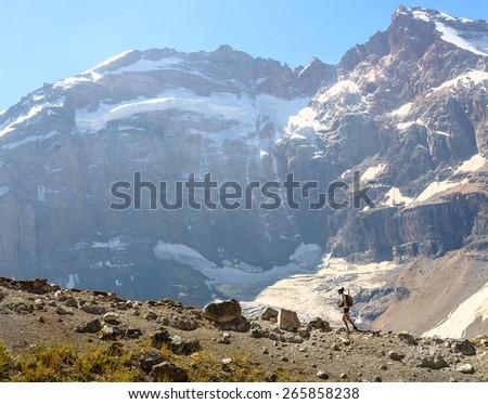 Man trekking in hight mountain - stock photo