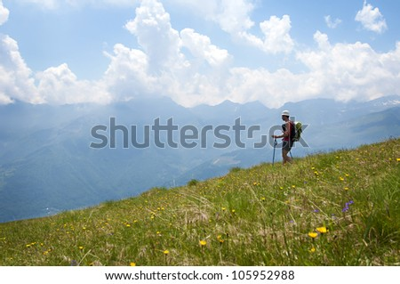 Man trekking in the Alps in a beautiful sunny day - stock photo