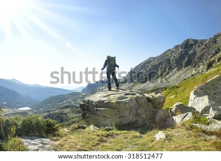 Man Trekking on the Mountain with Backpack and Trekking Poles