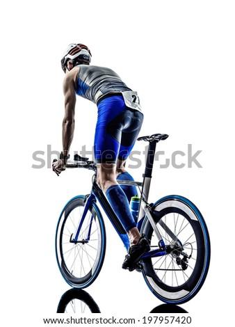 man triathlon iron man athlete biker cyclist bicycling biking in silhouette on white background - stock photo