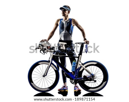 man triathlon iron man athlete standing with all his equipment in silhouettes on white background - stock photo