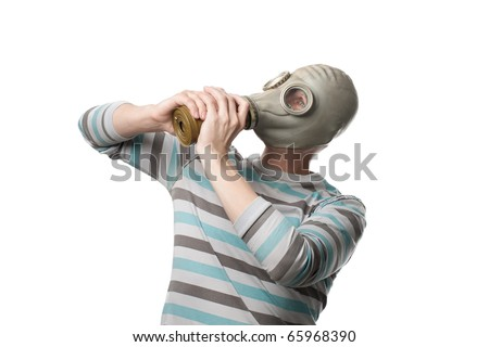 Man trying to remove a gas mask from his head against white background - stock photo