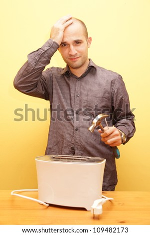 Man trying to repair a broken toaster