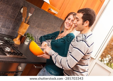 Man Trying to Taste Something in the Kitchen