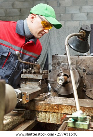 man  turner works for lathe  - stock photo