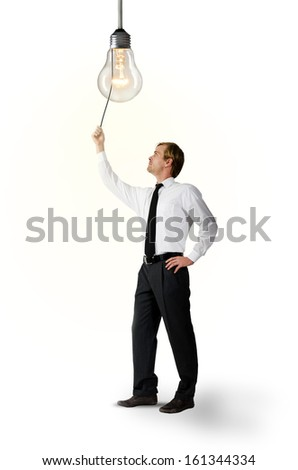 man turns on the light over white - stock photo