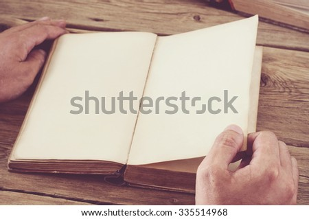 Man turns the page book close up. Top view. Copy space. Free space for text.  - stock photo