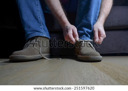 man tying casual shoes - stock photo