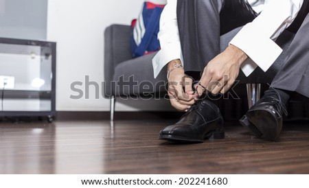 Man tying shoes - stock photo