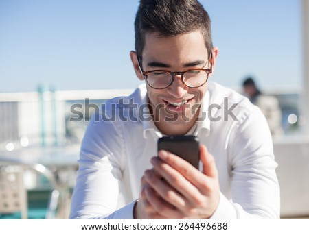 man typing in a mobile - stock photo