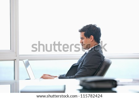Man typing on a computer in an office - stock photo