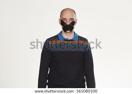 Man unable to speak - stock photo