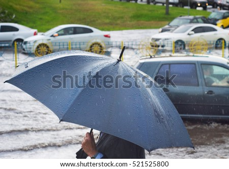 Man under umbrella in the rain