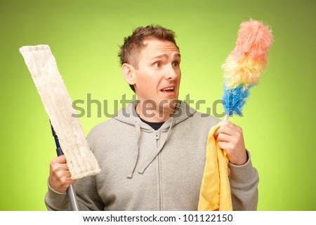 Man unhappy, confused and unsure being not prepared to clean a house - stock photo