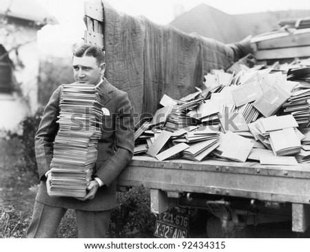 Man unloading a truck full of letters - stock photo