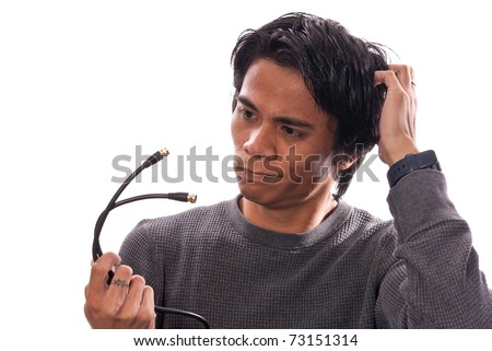 Man Unsure of What to Do with Wires