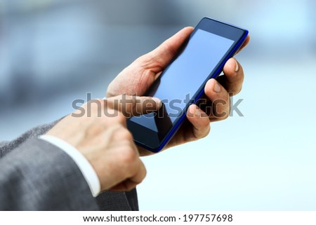 man use a mobile phone - stock photo