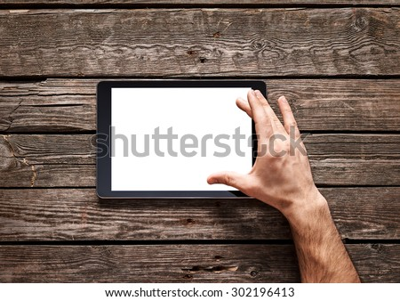 Man use a spread gesture on touch screen of digital tablet. Clipping path included.
