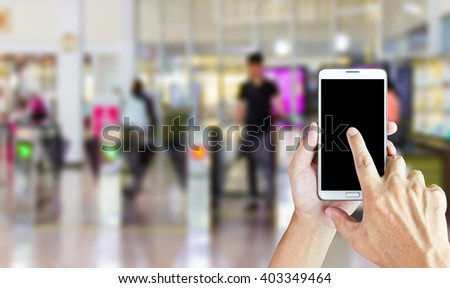 Man use mobile phone,blur image of check point in building as background. - stock photo