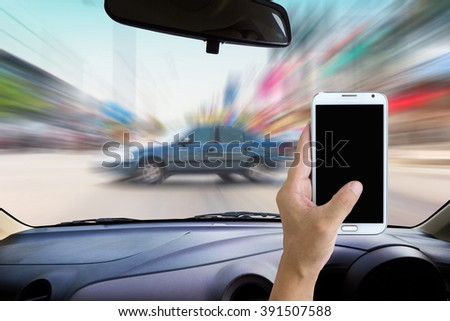 Man use mobile phone in the car, motion of accident as background. - stock photo