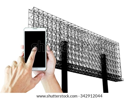 Man use smart phone ,blur image of big steel billboard as background. - stock photo