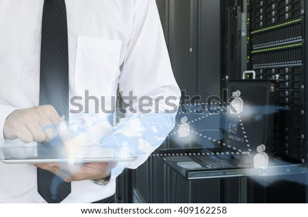 man use tablet in data center for working  - stock photo