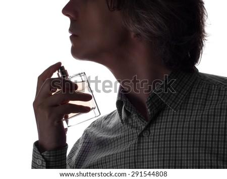 man uses perfume - stock photo