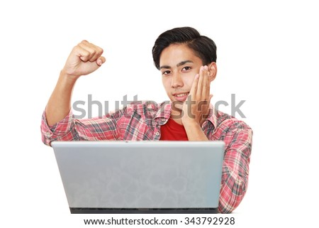 Man using a laptop - stock photo