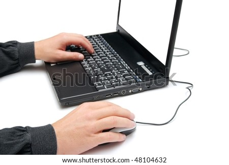 Man using a laptop isolated on white