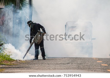 Man using a nebulizer, killing mosquitoes.