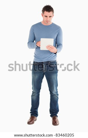 Man using a tablet computer against a white background - stock photo