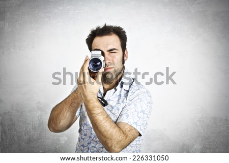 Man using a video camera - stock photo