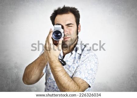 Man using a videocamera  - stock photo