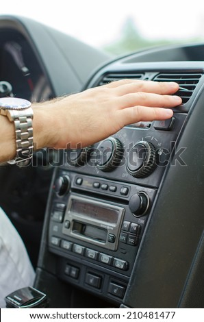 Man using automobile air conditioning system.