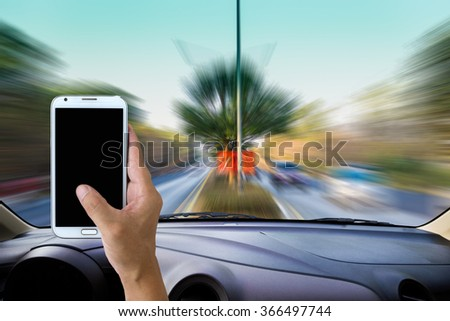 Man using cell phone while driving . - stock photo
